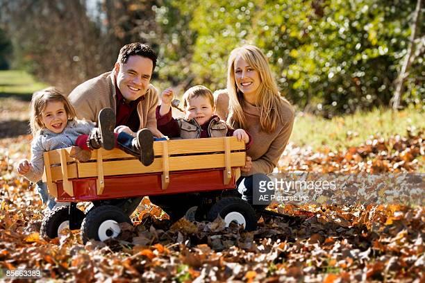 Autumn portrait of family in wagon