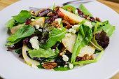 A crisp autumn apple, pecan, feta salad with a cider vinaigrette
