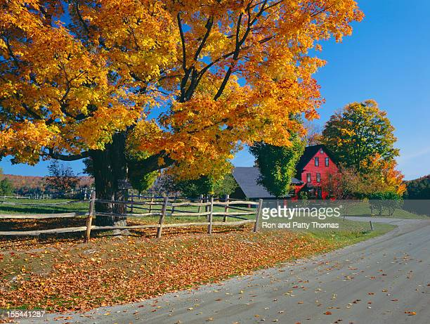 Autumn scene in rural Vermont with Fall foliage and red barn