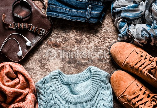 b4067bd5 Autumn set of women's clothing - suede shoes, jeans, knitted pullover,  scarf, shoulder bag, accessories on a wooden background, top view. Urban  style ...