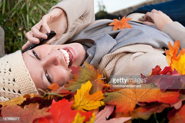 Autumn Smiling woman talking on phone