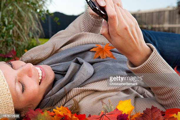 Autumn Smiling woman texting on phone