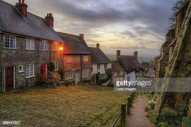 Autumn sunrise over Gold Hill in Dorset