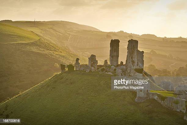 Autumn sunrise over the Corfe Castle ruins in Dorset taken on October 15 2012 The castle dates back to the 11th century