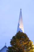 Autumn tree and church in Main street