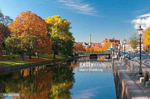 Autumn trees reflecting on river in Rosenlundskanalen