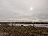 autumn winter dark cloudy overcast harbour scene estuary; essex; england; uk