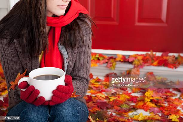 Autumn: Young female holding coffee mug