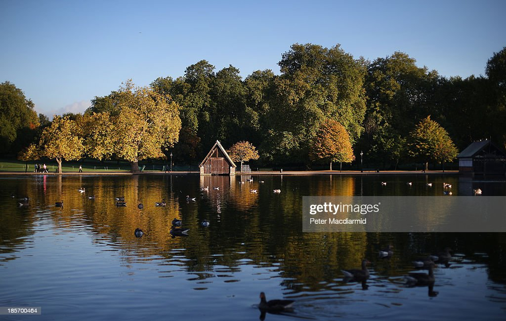 Autumnal colours are reflected in the Serpentine in Hyde Park on October 24, 2013 in London, England. Fine weather is expected in parts of the United Kingdom today.