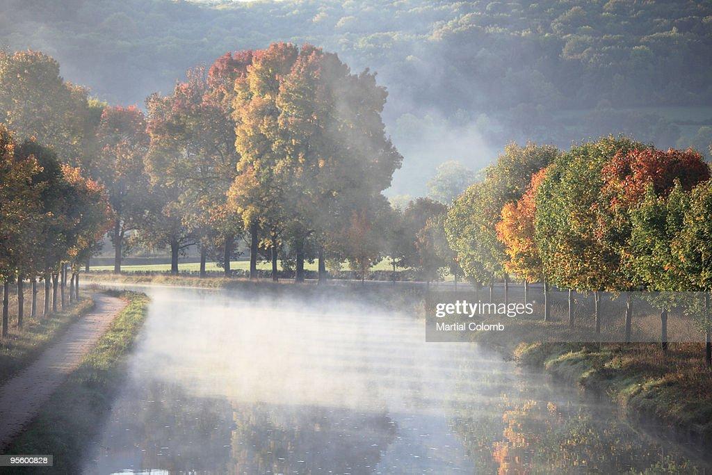 autumnal mist on burgundy ship canal : Stock Photo
