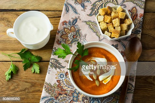Autumnal spicy pumpkin cream soup : Stock Photo