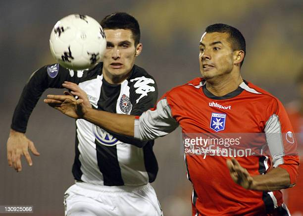 Auxerre Sebastian Jean Jaures right run for the ball with Nenad Marinkovic left from Partizan Belgrade during Uefa Cup Group A match between Partizan...