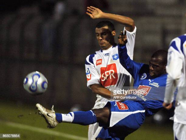 Auxerre's French defender Jean Sebastien Jaures vies with Niort's forward Fabrice Seidou during their French Cup football match Auxerre against Niort...