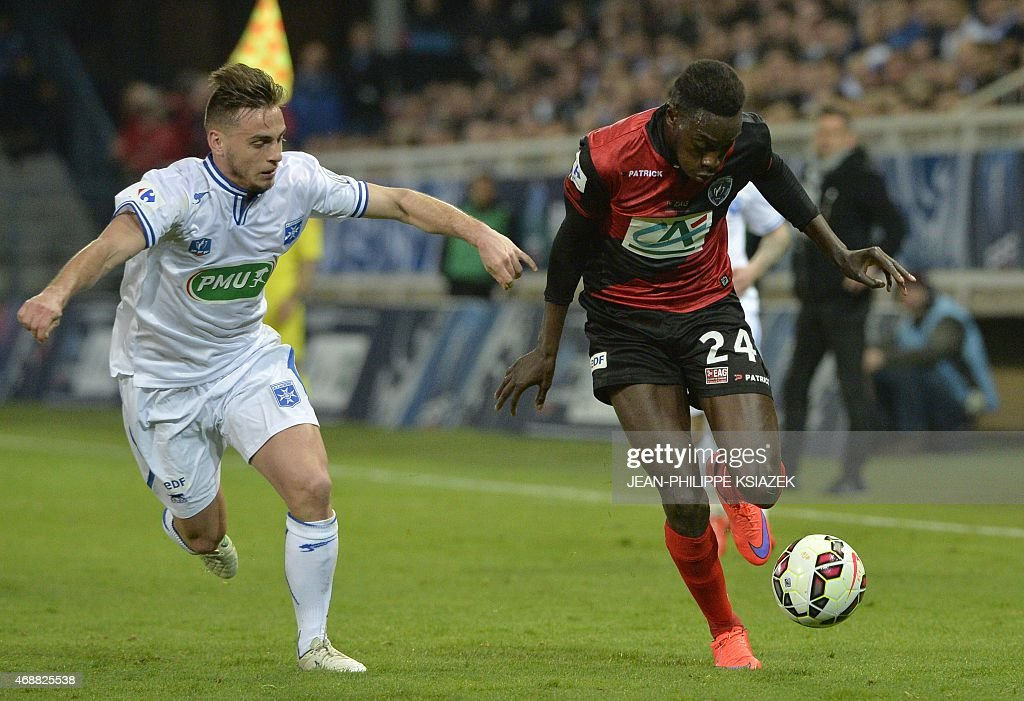 Auxerre's French defender Ruben Aguilar (L) vies with Guingamp's French midfielder <a gi-track='captionPersonalityLinkClicked' href=/galleries/search?phrase=Sambou+Yatabare&family=editorial&specificpeople=5747366 ng-click='$event.stopPropagation()'>Sambou Yatabare</a> (R) during the French Cup football match between Auxerre and Guingamp on April 7, 2015 at the l'Abbe-Deschamps stadium in Auxerre.