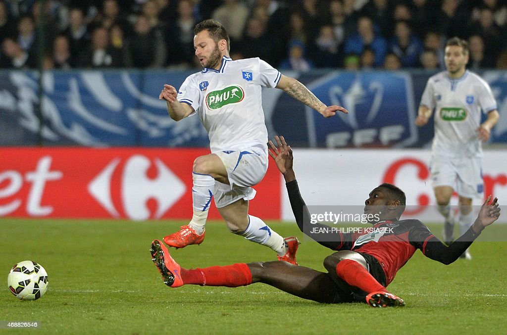 Auxerre's French forward <a gi-track='captionPersonalityLinkClicked' href=/galleries/search?phrase=Frederic+Sammaritano&family=editorial&specificpeople=2299558 ng-click='$event.stopPropagation()'>Frederic Sammaritano</a> (L) fights for the ball with Guingamp midfielder <a gi-track='captionPersonalityLinkClicked' href=/galleries/search?phrase=Sambou+Yatabare&family=editorial&specificpeople=5747366 ng-click='$event.stopPropagation()'>Sambou Yatabare</a> (R) on April 7, 2015 during a French Cup football match between Auxerre and Guingamp at the l'Abbe-Deschamps stadium in the central French town of Auxerre.