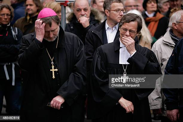 Auxiliary Bishop Matthias Heinrich and Bishop Markus Droege stand together during the ecumenical Good Friday procession on April 18 2014 in Berlin...