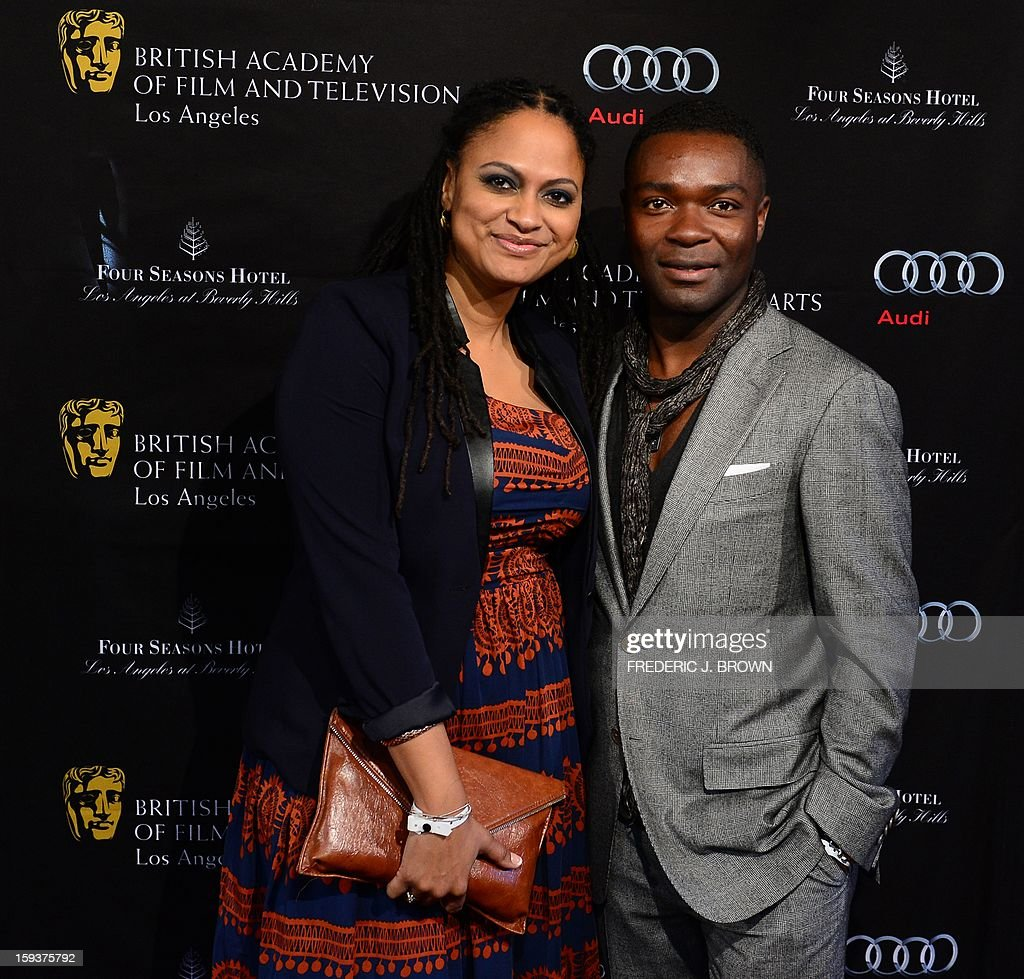 Ava DuVernay (L) and guest pose on arrival for the British Academy of Film and Television Arts (BAFTA) Los Angeles Awards Season Tea Party on January 12, 2013 in Beverly Hills, California. AFP PHOTO / Frederic J. BROWN