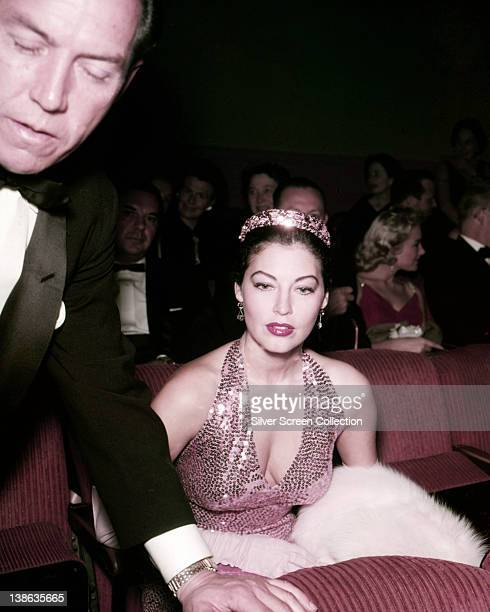 Ava Gardner US actress wearing a pink sequinned halterneck dress with a matching tiara at an event circa 1955