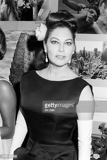 Ava Gardner wearing a flower in her hair at a formal event circa 1980 New York