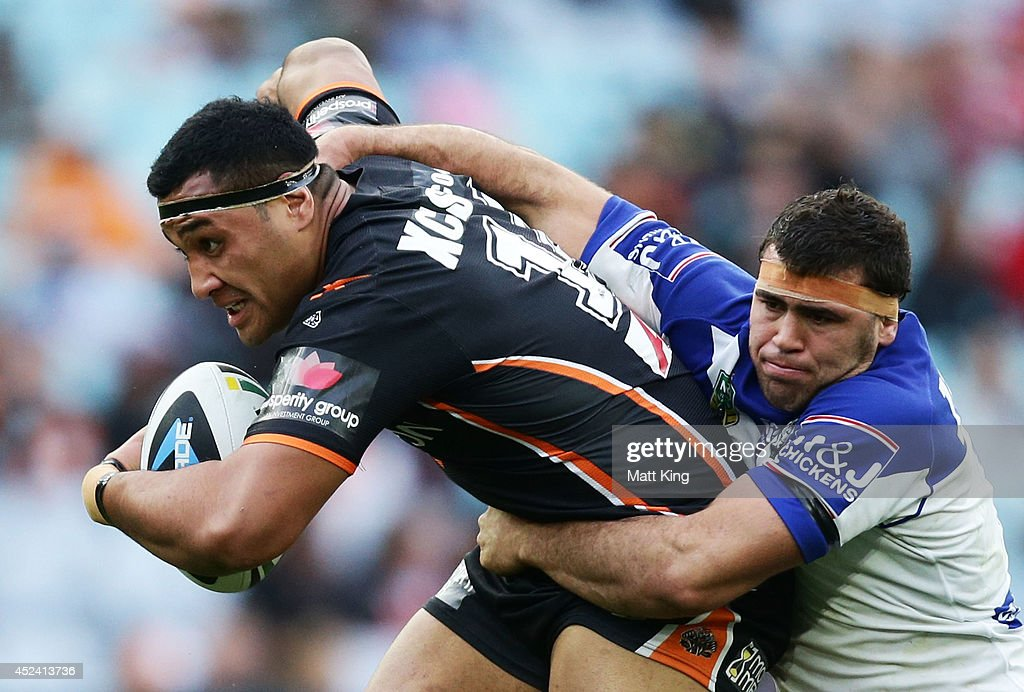 Ava Seumanufagai of the Tigers is tackled during the round 19 NRL match between the Wests Tigers and the Canterbury Bulldogs at ANZ Stadium on July 20, 2014 in Sydney, Australia.