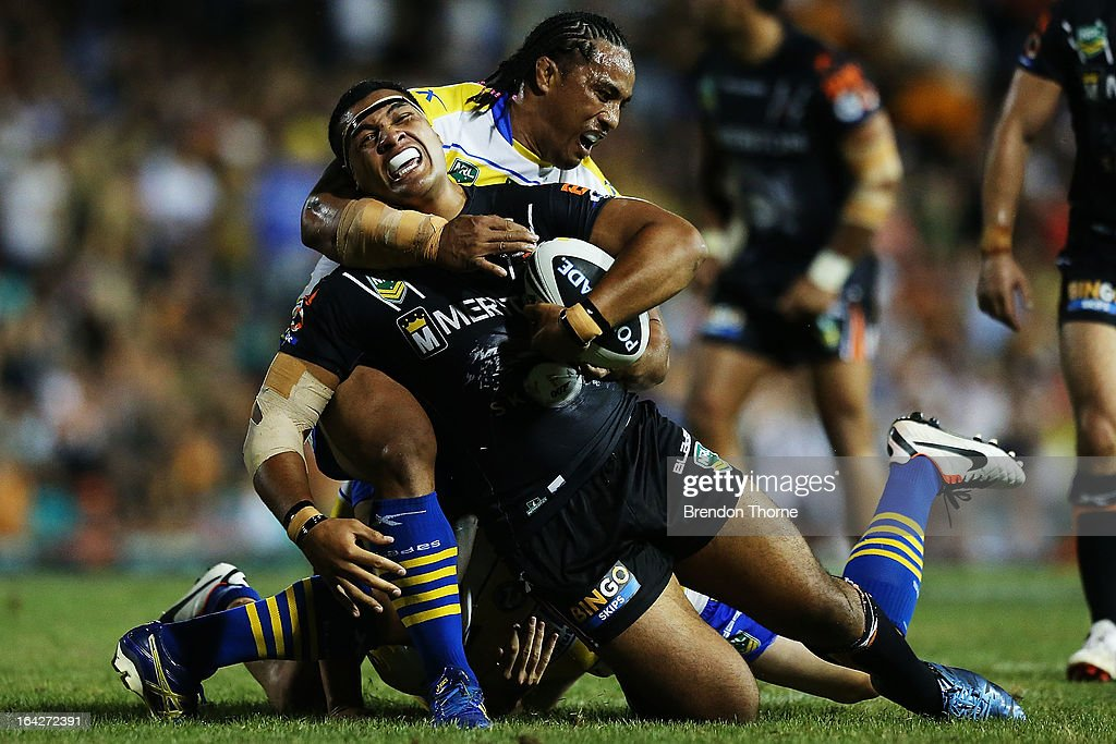 Ava Seumanufagi of the Tigers is tackled by Fuifui Moimoi of the Eels during the round three NRL match between the Wests Tigers and the Parramatta Eels at Leichhardt Oval on March 22, 2013 in Sydney, Australia.