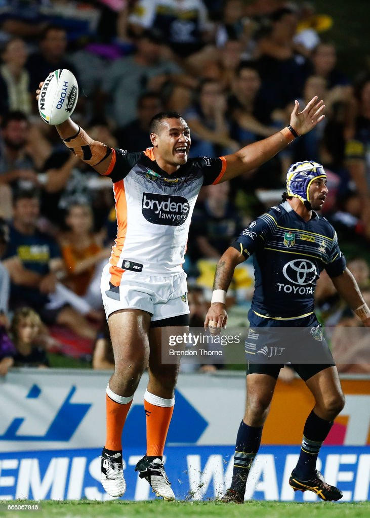 Avagalu Seumanufagai of the Tigers celebrates after scoring a try during the round six NRL match between the North Queensland Cowboys and the Wests Tigers at 1300SMILES Stadium on April 8, 2017 in Townsville, Australia.