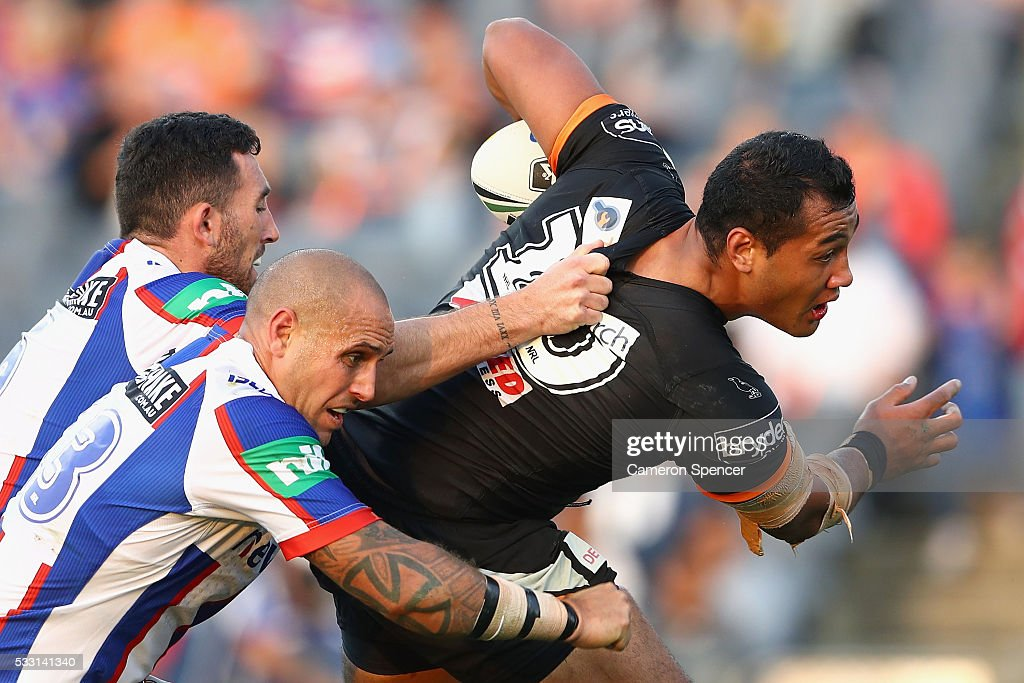 Avagalu Seumanufagai of the Tigers is tackled during the round 11 NRL match between the Wests Tigers and the Newcastle Knights at Campbelltown Sports...