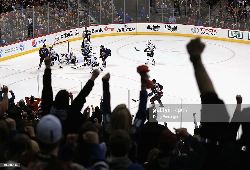 Avalanche fans celebrate a play by the Colorado Avalanche against the Chicago Blackhawks at the Pepsi Center on March 8, 2013 in Denver, Colorado. The Avalanche won 6-2 to end the Blackhawks 30 game undefeated streak.