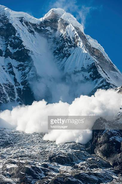 Avalanche thundering down Annapurna Himalayas mountains Nepal