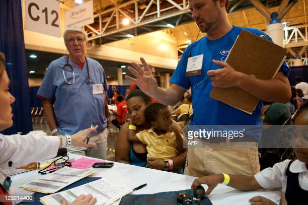 Avanna Parent of New Orleans LA sits with her two yearold son Leo and five yearold daughter Paige as they are assisted by Dr Kim Davis of Raleigh NC...