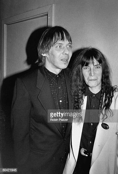 Avantgarde rock artist Patti Smith w husband Fred Sonic Smith at Arista Records 15th anniversary bash to raise money for AIDS