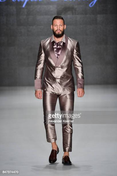 Avatar Atakan walks the runway at the Naz by Rufat Ismayilov show during MercedesBenz Istanbul Fashion Week September 2017 at Zorlu Center on...