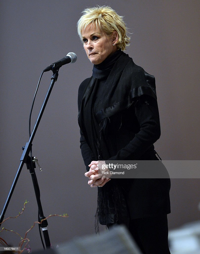 'Ave Maria' performed by <a gi-track='captionPersonalityLinkClicked' href=/galleries/search?phrase=Lorrie+Morgan&family=editorial&specificpeople=1063734 ng-click='$event.stopPropagation()'>Lorrie Morgan</a> during the memorial service for Mindy McCready at Cathedral of the Incarnation on March 6, 2013 in Nashville, Tennessee. McCready was found dead from an apparent suicide on February 17, 2013 at her home in Heber Springs, Arkansas.