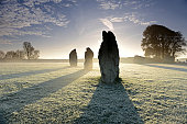 Stones at Avebury in misty morning , England