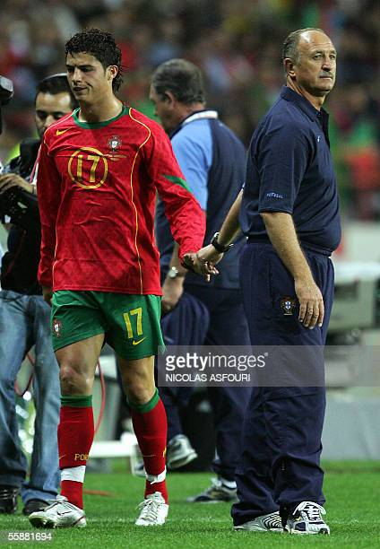 Portugal's coach Felipe Scolari shakes the hand of Cristiano Ronaldo after he replaced him with Nuno Gomes during the 2006 World Cup qualifier...