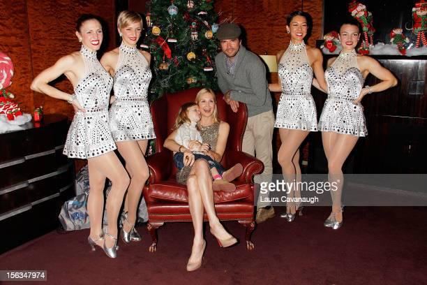 Aven Settle Kelly Rutherford Matthew Settle and Rockettes Alina Duncan Mary Cavett Naomi Kakuk and KT Wilson attend 2012 Radio City Christmas...