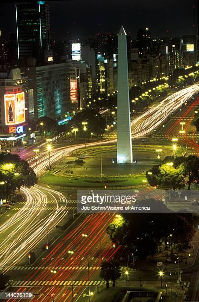 Avenida 9 de Julio widest avenue in the world and El Obelisco The Obelisk at night Buenos Aires Argentina