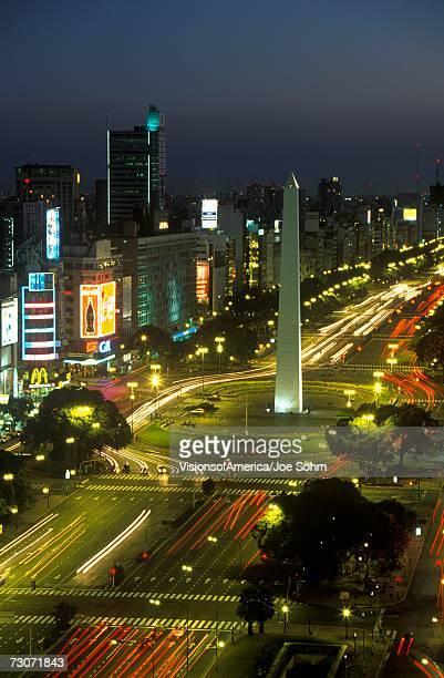 'Avenida 9 de Julio, widest avenue in the world, and El Obelisco, The Obelisk at night, Buenos Aires, Argentina'