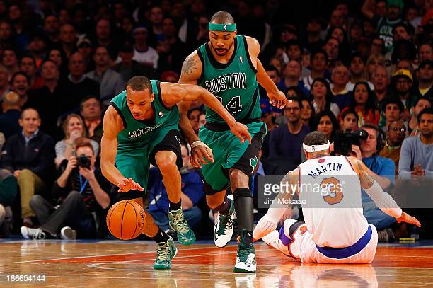 Avery Bradley and Chris Wilcox of the Boston Celtics in action against Kenyon Martin of the New York Knicks at Madison Square Garden on March 31 2013...