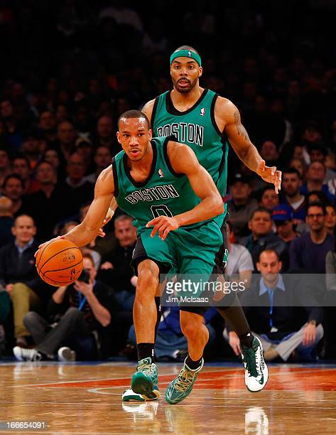 Avery Bradley and Chris Wilcox of the Boston Celtics in action against the New York Knicks at Madison Square Garden on March 31 2013 in New York City...