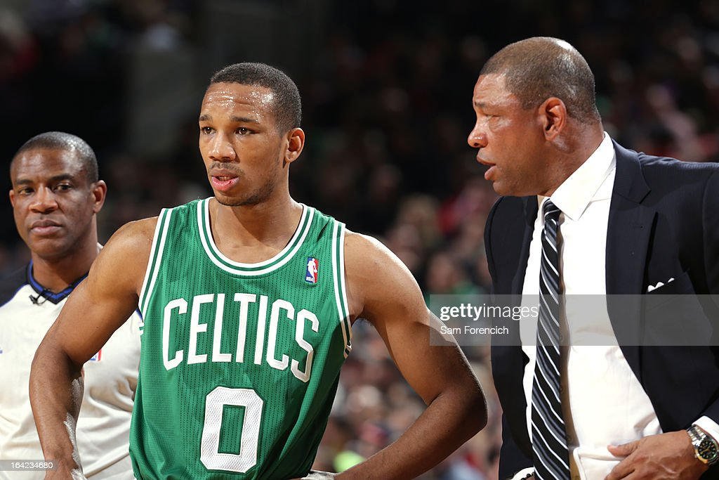 Avery Bradley #0 and Doc Rivers of the Boston Celtics discuss a play during the game against the Portland Trail Blazers on February 24, 2013 at the Rose Garden Arena in Portland, Oregon.