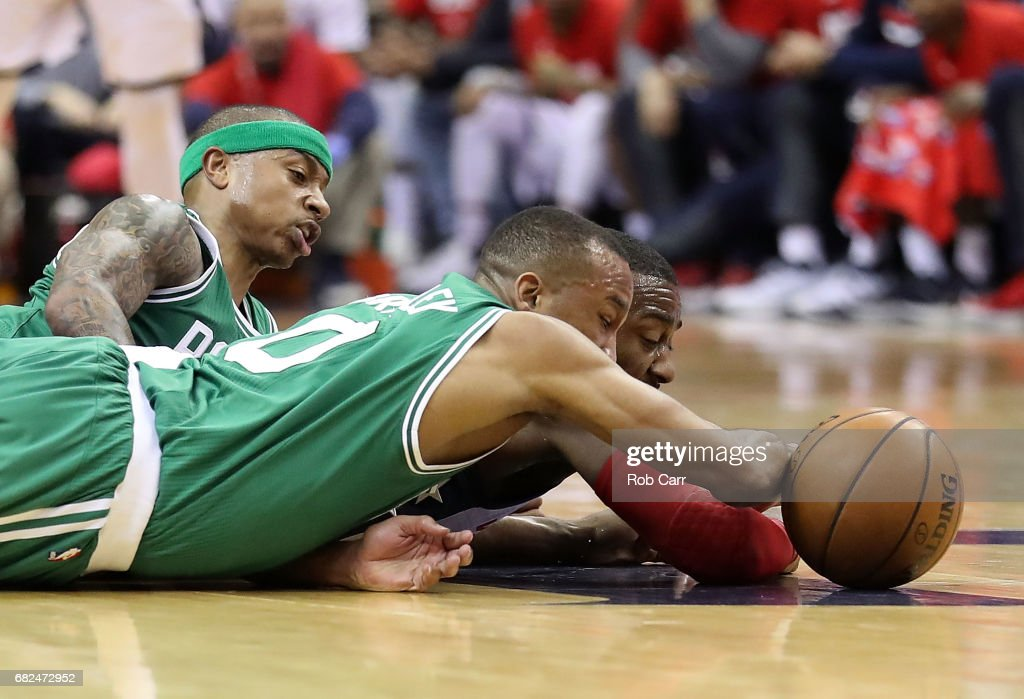 Avery Bradley #0 and Isaiah Thomas #4 of the Boston Celtics dive for a loose ball against John Wall #2 of the Washington Wizards during Game Six of the NBA Eastern Conference Semi-Finals at Verizon Center on May 12, 2017 in Washington, DC.