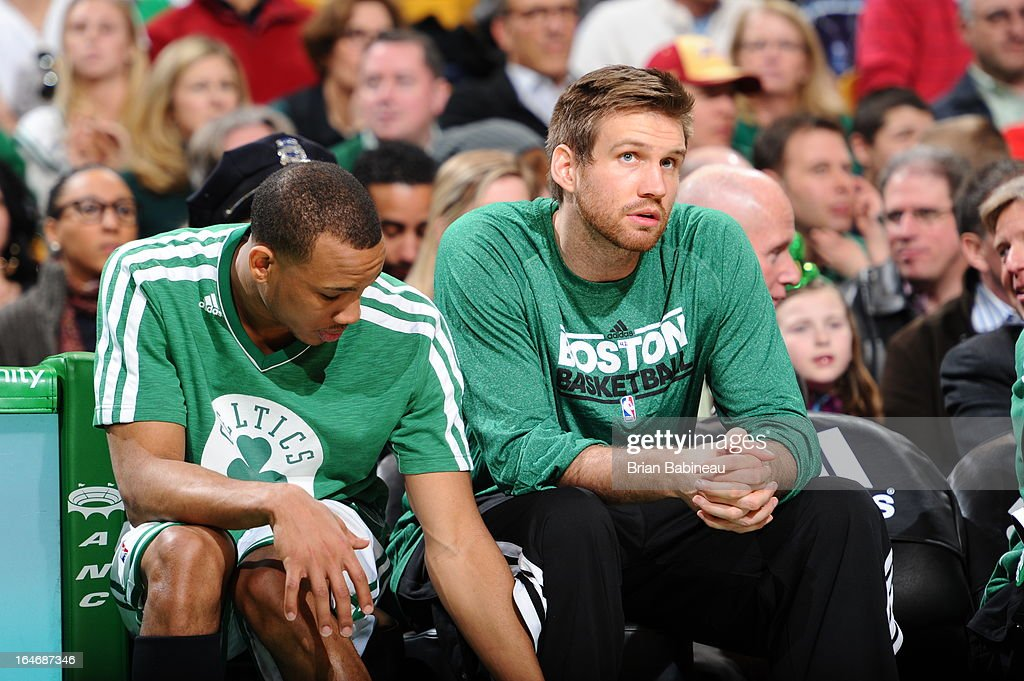 Avery Bradley #0 and Shavlik Randolph #42 of the Boston Celtics sit on the bench during the game against the Golden State Warriors on March 1, 2013 at the TD Garden in Boston, Massachusetts.