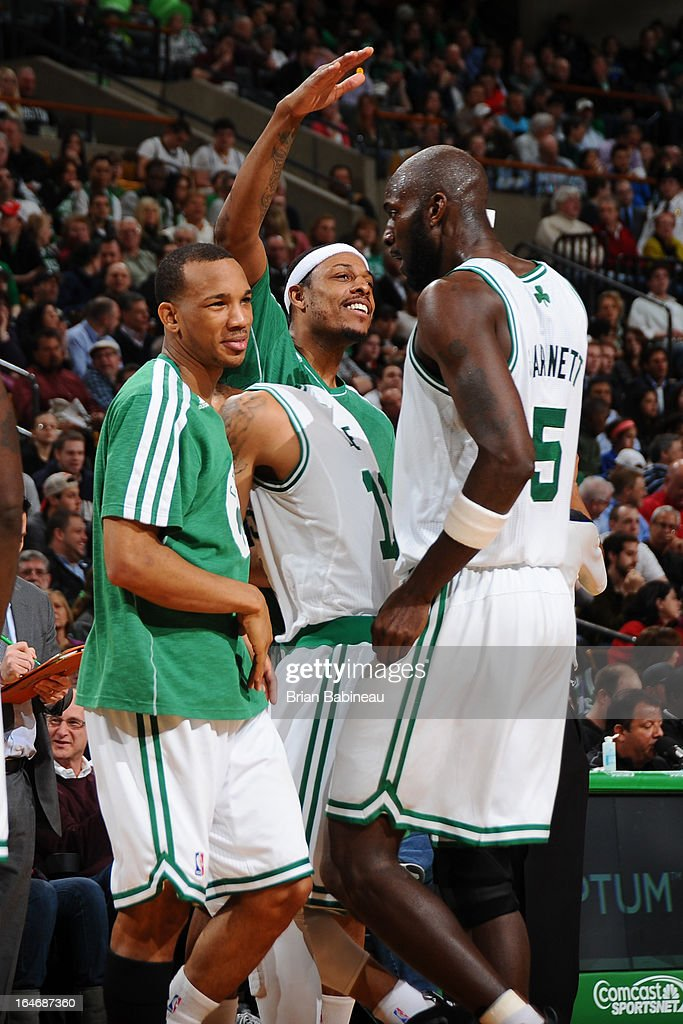 Avery Bradley #0, Courtney Lee #11, Paul Pierce #34 and Kevin Garnett #5 of the Boston Celtics huddle up by the bench during the game against the Golden State Warriors on March 1, 2013 at the TD Garden in Boston, Massachusetts.