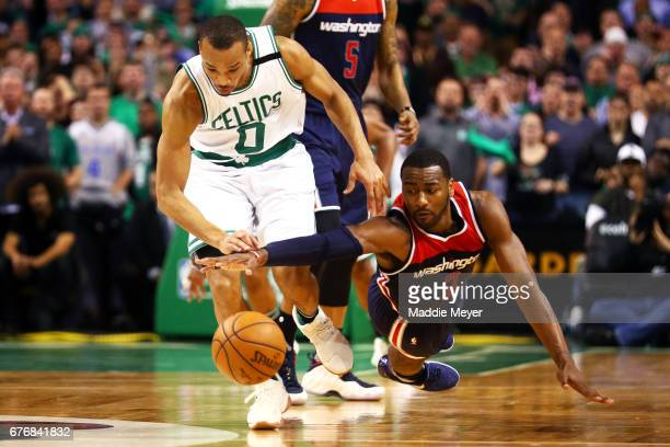Avery Bradley of the Boston Celtics and John Wall of the Washington Wizards battle for a loose ball during overtime in the Celtics 129119 win over...