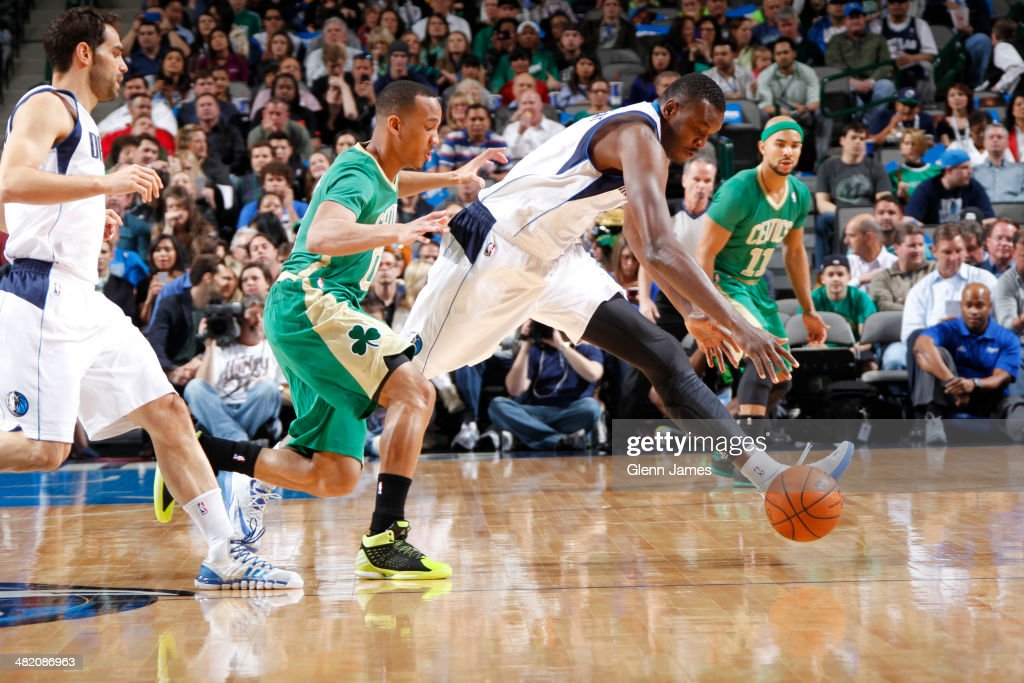 <a gi-track='captionPersonalityLinkClicked' href=/galleries/search?phrase=Avery+Bradley&family=editorial&specificpeople=5792051 ng-click='$event.stopPropagation()'>Avery Bradley</a> #0 of the Boston Celtics and <a gi-track='captionPersonalityLinkClicked' href=/galleries/search?phrase=Samuel+Dalembert&family=editorial&specificpeople=202026 ng-click='$event.stopPropagation()'>Samuel Dalembert</a> #1 of the Dallas Mavericks chase a loose ball during the game on March 17, 2014 at the American Airlines Center in Dallas, Texas.
