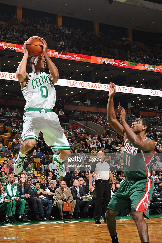 Avery Bradley #0 of the Boston Celtics attempts to shoot against Brandon Knight #11 of the Milwaukee Bucks on December 3, 2013 at the TD Garden in Boston, Massachusetts.