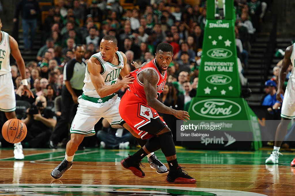 Avery Bradley #0 of the Boston Celtics battles for a loose ball against Nate Robinson #2 of the Chicago Bulls on February 13, 2013 at the TD Garden in Boston, Massachusetts.