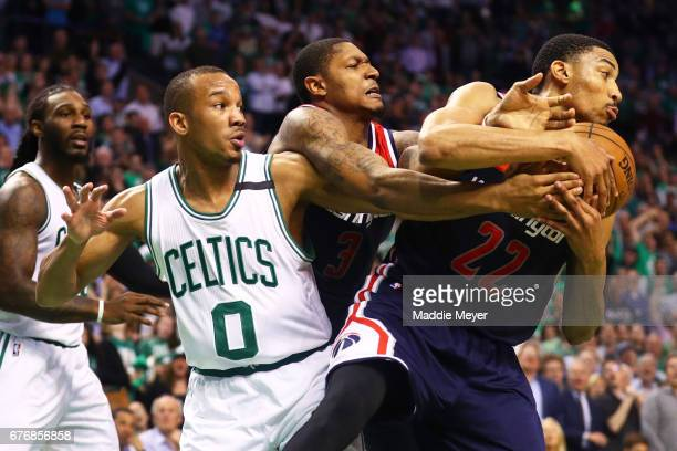 Avery Bradley of the Boston Celtics Bradley Beal and Otto Porter Jr #22 of the Washington Wizards battle for a rebound during the fourth quarter of...