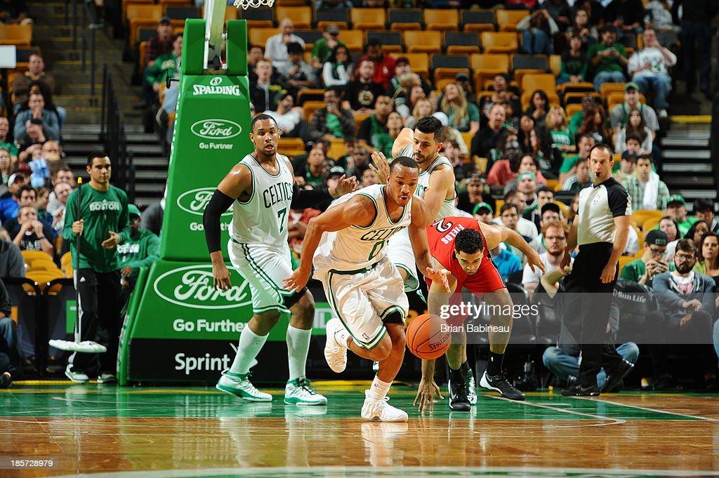 Avery Bradley #0 of the Boston Celtics brings the ball up court against the Toronto Raptors on October 7, 2013 at the TD Garden in Boston, Massachusetts.